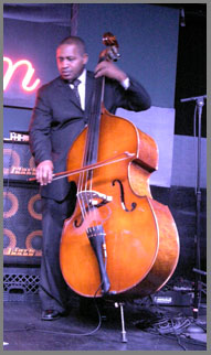 Trevor Ware on Upright Bass at the Iridium NYC - Photo by Luxury Experience